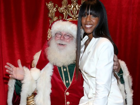Kelly Rowland doesn't care it's October as she poses on Santa's lap at Christmas bash