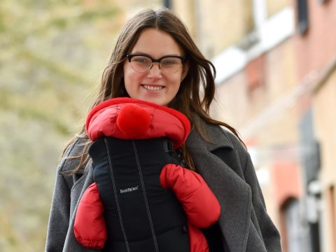 Keira Knightley is all smiles as she cuddles up to new baby daughter Delilah