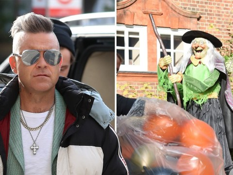 Robbie Williams takes terrifying Halloween decorations to the next level with a giant witch statue