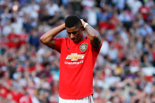 Manchester United's Marcus Rashford reacts after failing to score a penalty kick during the English Premier League soccer match between Manchester United and Crystal Palace at Old Trafford in Manchester