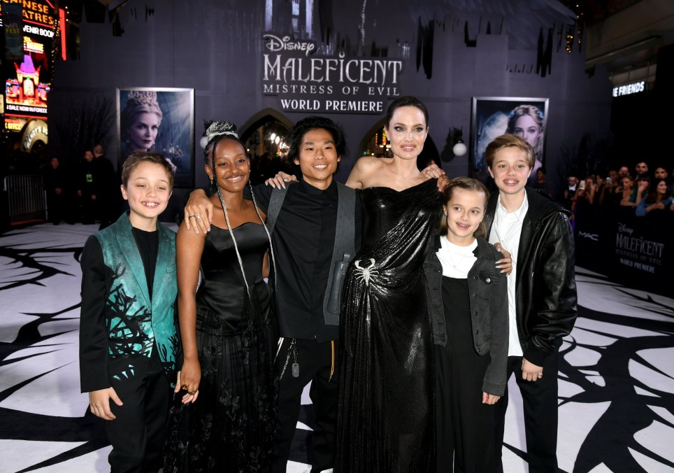 """LOS ANGELES, CALIFORNIA - SEPTEMBER 30: (L-R) Knox L??on Jolie-Pitt, Zahara Marley Jolie-Pitt, Pax Thien Jolie-Pitt, Angelina Jolie, Vivienne Marcheline Jolie-Pitt, and Shiloh Nouvel Jolie-Pitt attend the world premiere of Disney's Maleficent: Mistress Of Evil"""" at El Capitan Theatre on September 30, 2019 in Los Angeles, California. (Photo by Kevin Winter/Getty Images)"""
