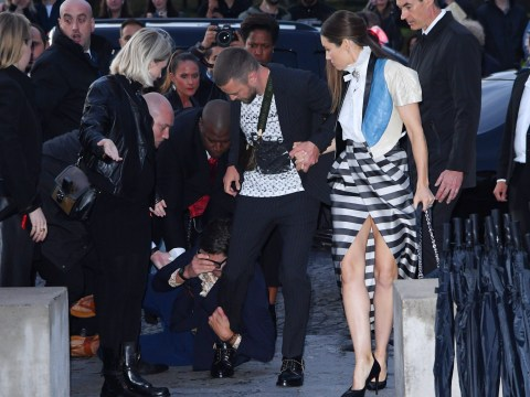 Justin Timberlake tackled by notorious prankster at Paris Fashion Week outside show with wife Jessica Biel