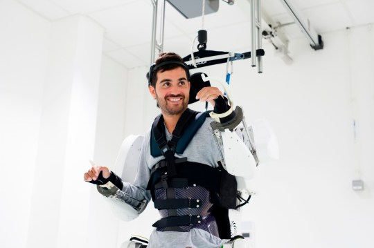 "This handout photograph taken on September 2019 and released by Clinatec Endowment Fund (fonds de dotation Clinatec) on October 3, 2019, shows French tetraplegic 'Thibault' as he stands while wearing an exo-skeleton at Clinatec laboratory at the University of Grenoble. - Paralysed since a fall four years ago, 'Thibault' now manages to direct the movements of an exoskeleton by thought, a kind of motorized armour. A first by French researchers, which opens up important perspectives for paraplegics. (Photo by HO / CLINATEC ENDOWMENT FUND / AFP) / RESTRICTED TO EDITORIAL USE - MANDATORY CREDIT ""AFP PHOTO / FONDS DE DOTATION CLINATEC - CLINATEC ENDOWMENT FUND"" - NO MARKETING - NO ADVERTISING CAMPAIGNS - DISTRIBUTED AS A SERVICE TO CLIENTS (Photo by HO/CLINATEC ENDOWMENT FUND/AFP via Getty Images)"