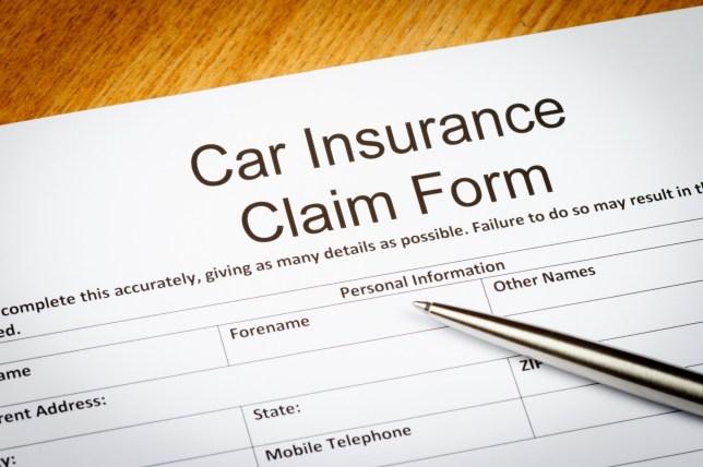 Car insurance clampdown A Car Insurance Claim Form on a desk with Ballpoint pen.