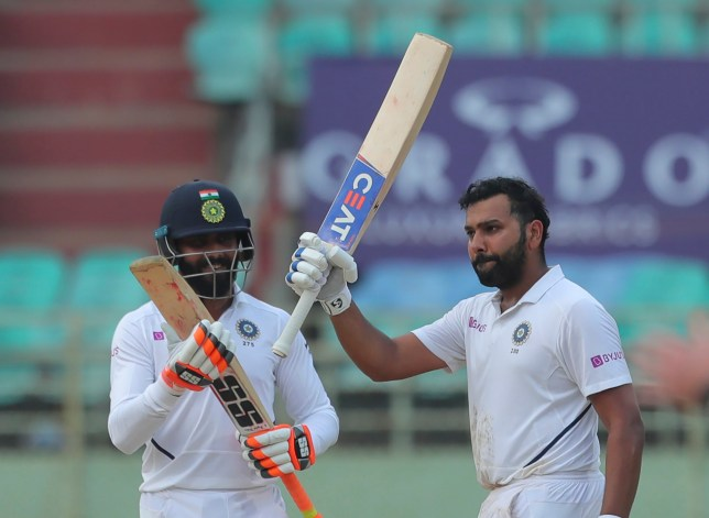 India's Rohit Sharma raises his bat after scoring a century during the fourth day of the first cricket test match against South Africa in Visakhapatnam, India, Saturday, Oct. 5, 2019. (AP Photo/Mahesh Kumar A.)