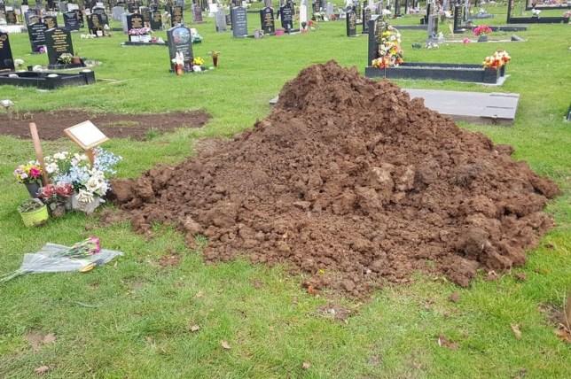Devastated widow finds husband's grave under mound of soil in cemetery