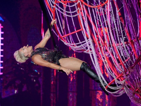 Pink is a vision as she swings from chandelier during acrobatic performance at Rock In Rio Music Festival