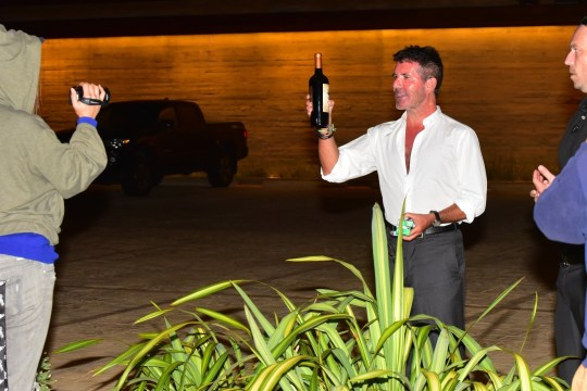 Los Angeles, CA - Simon Cowell leaves Nobu Malibu after 60th birthday celebrations. He then receives a bottle of wine from a videographer and was extremely grateful and gracious about it. He also high fived a fan that was passing by and recognized the mogul. Pictured: Simon Cowell BACKGRID USA 7 OCTOBER 2019 USA: +1 310 798 9111 / usasales@backgrid.com UK: +44 208 344 2007 / uksales@backgrid.com *UK Clients - Pictures Containing Children Please Pixelate Face Prior To Publication*