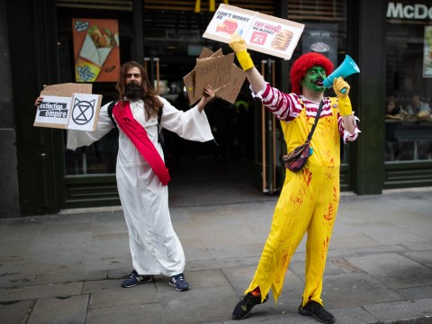 Santa, Jesus, and Ronald McDonald troll XR protesters saying 'Get a job'