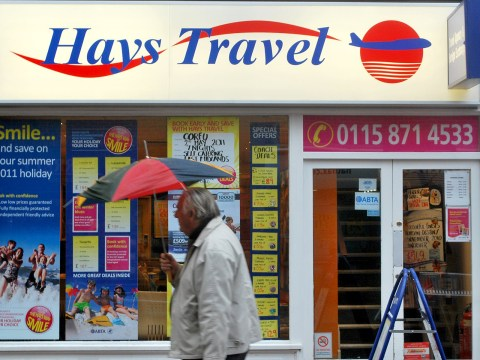 Who owns Hays Travel and how many Thomas Cook stores are they buying?