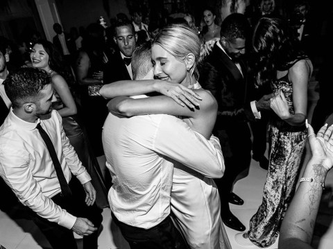 Justin Bieber rips off bride Hailey's garter with his teeth in new wedding photos