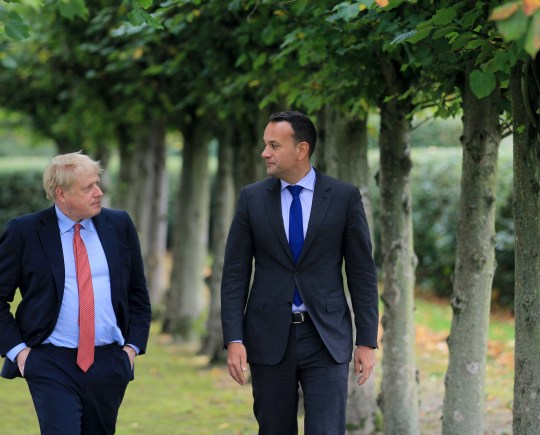 Ireland's Prime Minister, Leo Varadkar (L) and Britain's Prime Minister Boris Johnson (R) pose for a photograph at Thornton Manor Hotel, near Birkenhead, north-west England on October 10, 2019, as they met for Brexit talks. - British Prime Minister Boris Johnson will meet his Irish counterpart for last-ditch Brexit talks on Thursday, with just days left to strike an EU divorce deal and both sides blaming each other for the impasse. Johnson will sit down with Irish Prime Minister Leo Varadkar at an undisclosed location in northwest England following several days of recriminations over the failure to find an acceptable compromise. (Photo by Noel Mullen / POOL / AFP) (Photo by NOEL MULLEN/POOL/AFP via Getty Images)