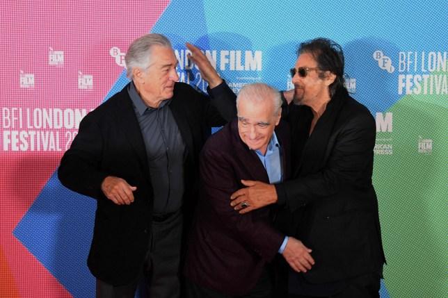 Martin Scorsese (C) embraces Al Pacino with Robert De Niro