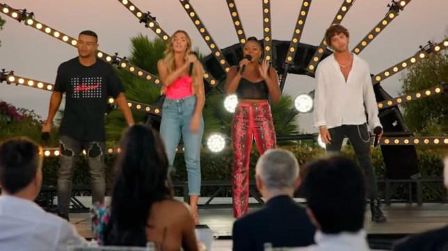 The Love Islanders performing on stage