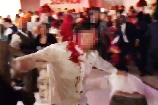 Four people were taken to hospital after a bloody brawl broke out at a lavish wedding party in a posh hotel. The shocking scenes unfolded at Ramada Park Hall Hotel in Wolverhampton just after 9.30pm on Saturday [October 12]. Caption: Still from mobile phone footage of a brawl at Ramada Park Hall Hotel in Wolverhampton on October 12, 2019