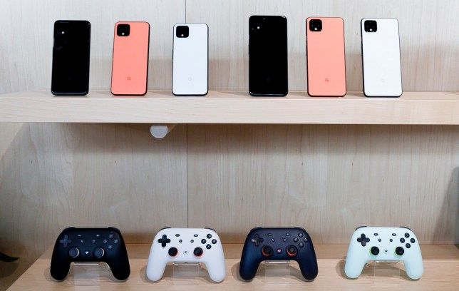 epa07922946 A display of the new Google Pixel 4 phones (top) and the Google Stadia cloud-based gaming system controllers, during a Google product launch event called 'Made by Google '19' in New York, New York, USA, 15 October 2019. The company introduced a number of new products at the event including a new phone, a new laptop, earbuds, and a new smart speaker. EPA/JUSTIN LANE