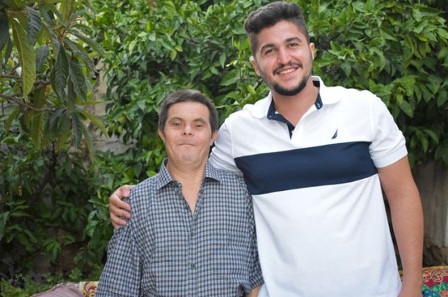 Son, Sader Issa with his dad who has downs syndrome