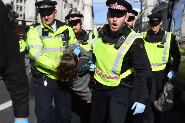A protesters is removed by police at Oxford Circus, London, during an Extinction Rebellion (XR) climate change protest. PA Photo. Picture date: Friday October 18, 2019. See PA story ENVIRONMENT Protests. Photo credit should read: Kirsty O'Connor/PA Wire
