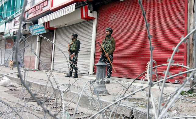 Mandatory Credit: Photo by Saqib Majeed/SOPA Images/REX (10450024a) Paramilitary troopers stand on guard during the shutdown Lock-down continues, Srinagar, India - 18 Oct 2019 Kashmir valley continued to remain shut on the 75th consecutive day against the abrogation of Article 370 by central government which grants special status to Jammu & Kashmir.