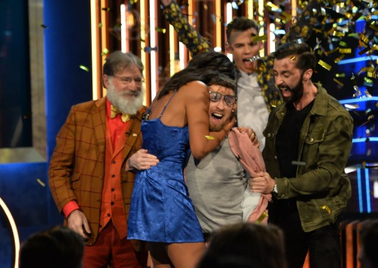 Paddy Smyth (centre, in pink), with finalists (left to right) Tim Wilson, Georgina Elliott, Woody Cook and James Doran, as he is crowned the winner of the second series of Channel 4's The Circle in Salford, Manchester. PA Photo. Picture date: Friday October 18, 2019. See PA story SHOWBIZ Circle. Photo credit should read: Peter Powell/PA Wire