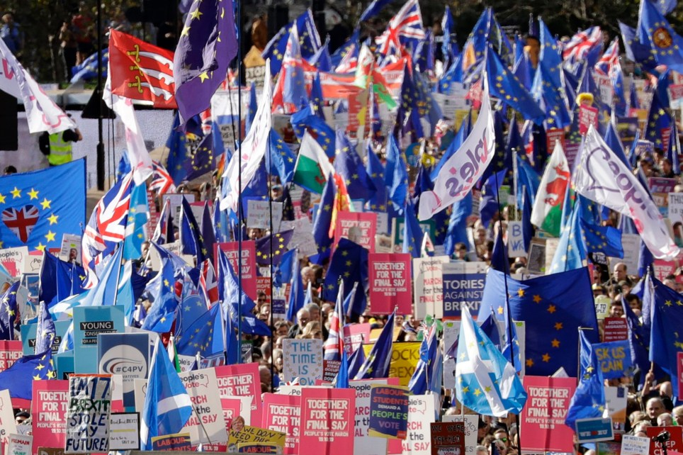 Anti-Brexit protestors march in London, Saturday, Oct. 19, 2019. Britain's Parliament is set to vote in a rare Saturday sitting on Prime Minister Boris Johnson's new deal with the European Union, a decisive moment in the prolonged bid to end the Brexit stalemate. Various scenarios may be put in motion by the vote. (AP Photo/Matt Dunham)