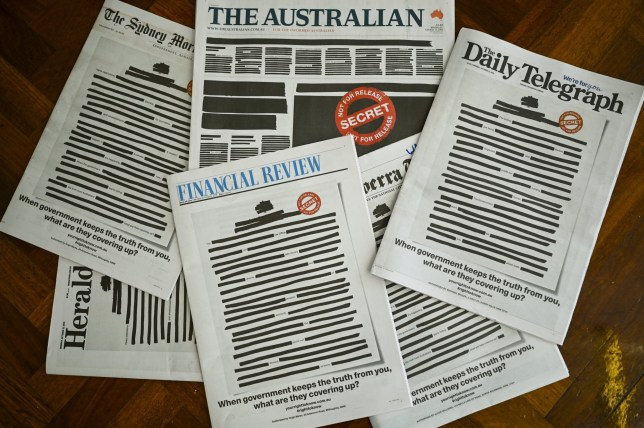 """Front pages of major Australian newspapers show a 'Your right to know"""" campaign, in Canberra, Australia, October 21, 2019. Australia's biggest newspapers ran front pages on Monday made up to appear heavily redacted to protest against recent legislation that restricts press freedoms, a rare show of unity by the usually tribal media industry. AAP Image/Lukas Coch/via REUTERS ATTENTION EDITORS - THIS IMAGE WAS PROVIDED BY A THIRD PARTY. NO RESALES. NO ARCHIVE. AUSTRALIA OUT. NEW ZEALAND OUT."""