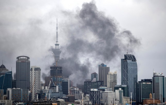 Smoke billows across the central business district skyline Tuesday, Oct. 22, 2019, in Auckland, New Zealand. A large fire that broke out on the roof of a convention center that's under construction in downtown Auckland sent plumes of thick black smoke over New Zealand's largest city. (Michael Craig/New Zealand Herald photograph via AP)