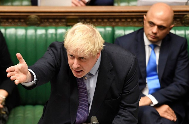Prime Minister Boris Johnson gestures as he speaks in the House of Commons