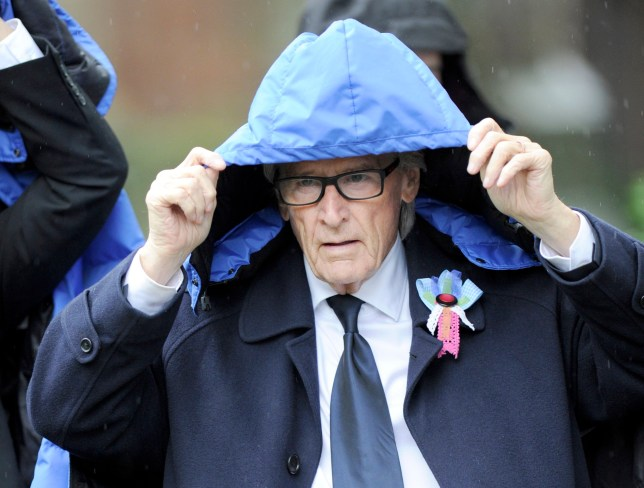 The show must go on. Coronation Street cast arrive to film on location in a torrential downpour. Bill Roache covers up. PIC BY MARK CAMPBELL/MCPIX 07778 526193