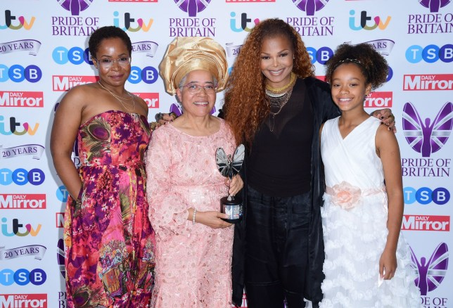Dame Elizabeth Anionwu, seen with her family, with the Lifetime Achievement Award, presented by Janet Jackson, in the press room during the Pride of Britain Awards.