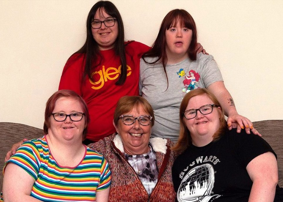 Woman adopts four girls with Down's syndrome