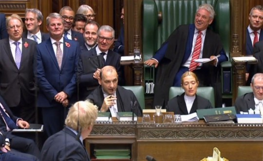 "A video grab from footage broadcast by the UK Parliament's Parliamentary Recording Unit (PRU) shows Speaker of the House of Commons John Bercow reacting as Britain's Prime Minister Boris Johnson delivers comments thanking him for his service in the Chair in the House of Commons in London at the stasrt of the weekly Prime Minister's Questions session (PMQs) on October 30, 2019. - Britain's political leaders tested their election pitches on October 30 after parliament backed Prime Minister Boris Johnson's bid for a pre-Christmas poll aimed at breaking the lengthy Brexit deadlock. Bercow is set to retire on October 31. (Photo by HO / various sources / AFP) / RESTRICTED TO EDITORIAL USE - MANDATORY CREDIT "" AFP PHOTO / PRU "" - NO USE FOR ENTERTAINMENT, SATIRICAL, MARKETING OR ADVERTISING CAMPAIGNS (Photo by HO/AFP via Getty Images)"