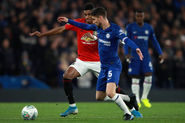 Chelsea's Jorginho vies for the ball with Manchester United's Marcus Rashford, left, during the English League Cup soccer match between Chelsea and Manchester United at Stamford Bridge in London, Wednesday, Oct. 30, 2019. (AP Photo/Ian Walton)
