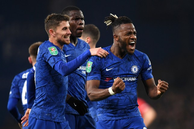 LONDON, ENGLAND - OCTOBER 30: Michy Batshuayi of Chelsea celebrates with Kurt Zouma and Jorginho after scoring his team's first goal during the Carabao Cup Round of 16 match between Chelsea and Manchester United at Stamford Bridge on October 30, 2019 in London, England. (Photo by Darren Walsh/Chelsea FC via Getty Images)