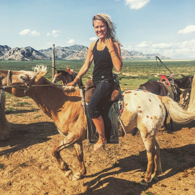 Sadie on a horse in Mongolia