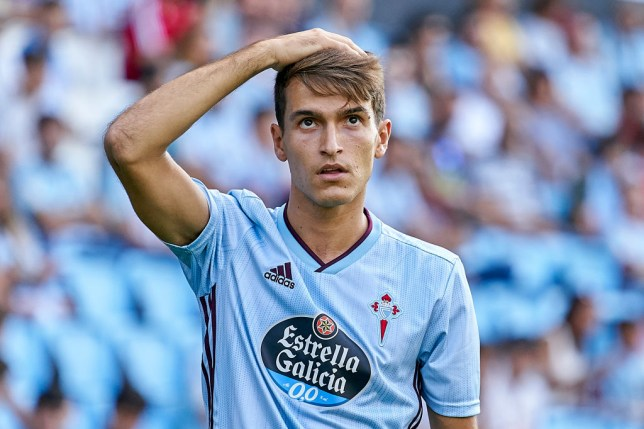 Denis Suarez pats his own head while in action for Celta Vigo