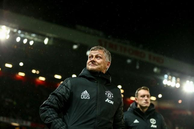 Ole Gunnar Solskjaer smiles before a Manchester United match