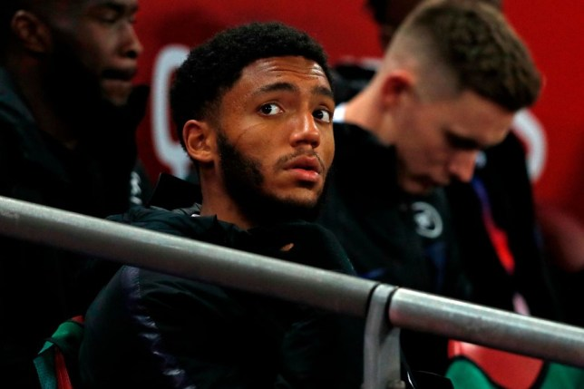 Joe Gomez looks on from the England bench during a game