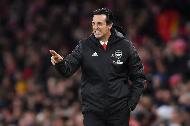 Unai Emery grimaces as he issues orders to his Arsenal players during a game
