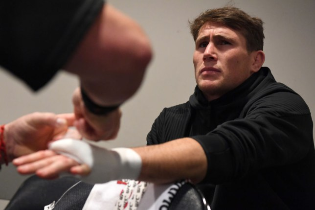 Darren Till makes a confused face as he gets his hands wrapped before a UFC fight
