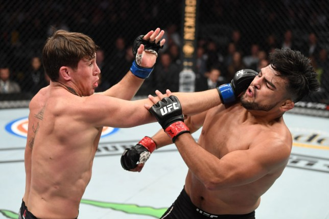 Darren TIll catches Kelvin Gastelum with a punch in their UFC fight