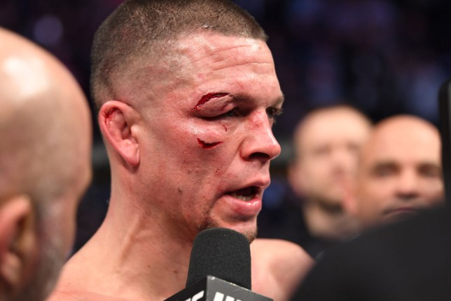 Nate Diaz is shown in the cage with two deep cuts on his face around his eye