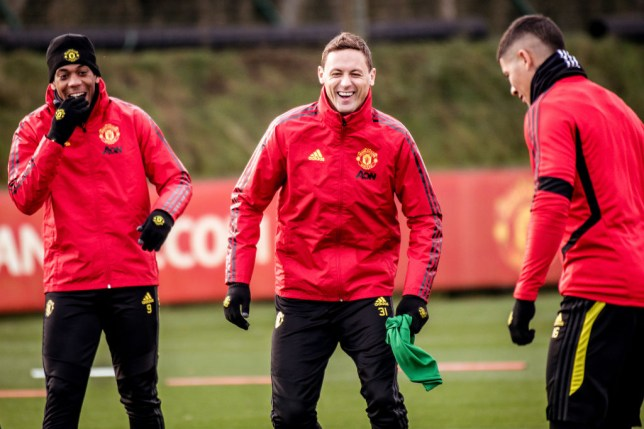 Nemanja Matic laughs with Anthony Martial in training for Manchester United