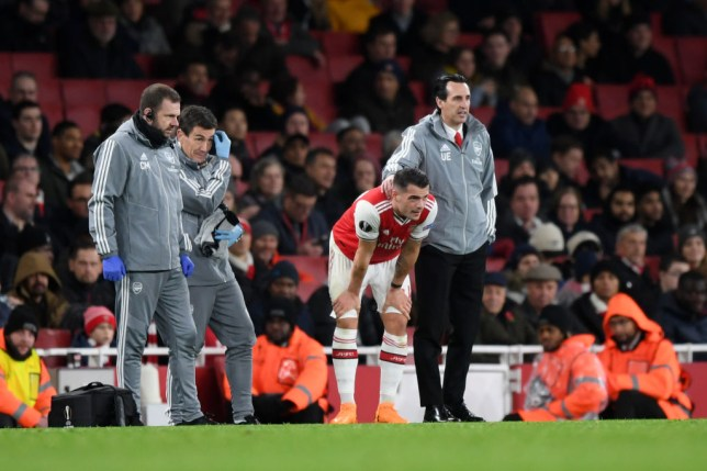 Unai Emery places a hand on the back of Granit Xhaka as he prepares to come back on for Arsenal