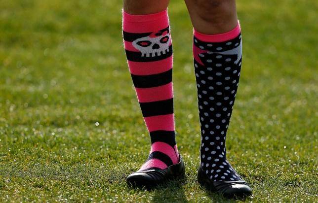 a child wearing odd socks