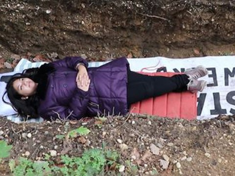 University students climb into their own makeshift 'grave' to relax