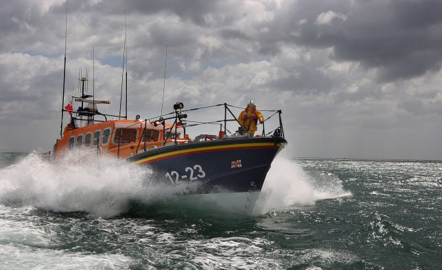 POOLE, UNITED KINGDOM - JULY 06: The Swanage Lifeboat of the Mersey Class cuts through the waves near Poole Harbour on July 6, 2007 in Dorset, England.The Royal National Lifeboat Institution (RNLI) is entirely funded by donations from the public. The RNLI runs 232 lifeboat stations around the coast of Great Britain and Ireland. The experimental lifeboat project's first lifeboat will be on service in 2011 and following that, the RNLI hope to eventually produce 30 - 40 of them in the long-term. (Photo by Peter Macdiarmid/Getty Images)