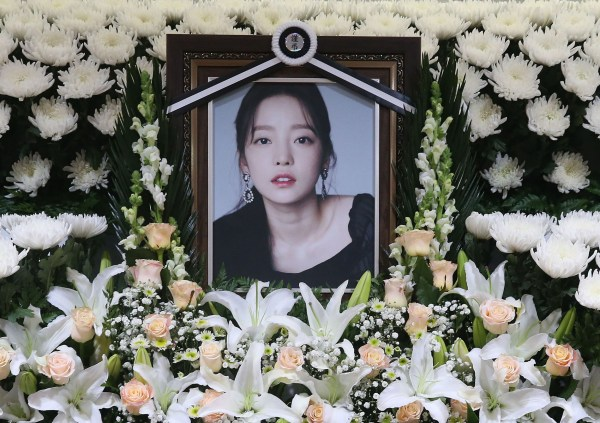 The portrait of late K-pop star Goo Hara is seen surrounded by flowers at a memorial altar at a hospital in Seoul on November 25, 2019. - Fans mourned and questions were asked November 25 after K-pop star and revenge porn victim Goo Hara was found dead in a possible suicide, which would make her the second female singer in a month to take her own life in the high-pressure industry. (Photo by str / Dong-A Ilbo / AFP) / South Korea OUT (Photo by STR/Dong-A Ilbo/AFP via Getty Images)