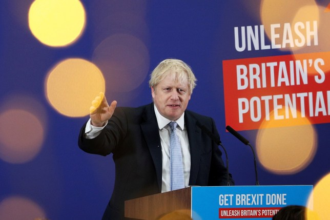 Britain's Prime Minister Boris Johnson makes a speech to an audience as he visits Healey's Cornish Cyder Farm, in Callestick, Britain, November 27, 2019. Dan Kitwood/Pool via REUTERS