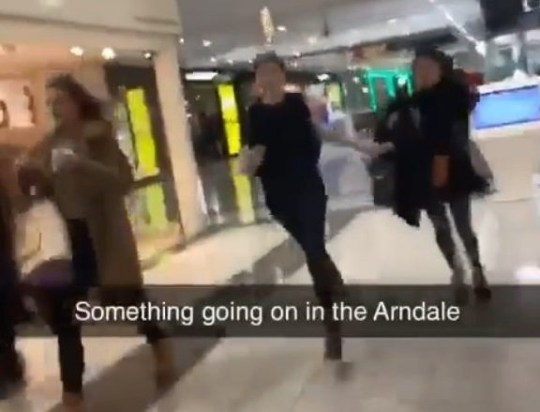 Police are investigating after fireworks were set off in the Arndale shopping centre in Manchester city centre, sending petrified shoppers 'running for their lives'. Several loud bangs were heard throughout the shopping centre on Wednesday afternoon. Pic shows phone footage of people in centre Credit: MEN